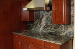 Kitchen with marble counter and backsplash