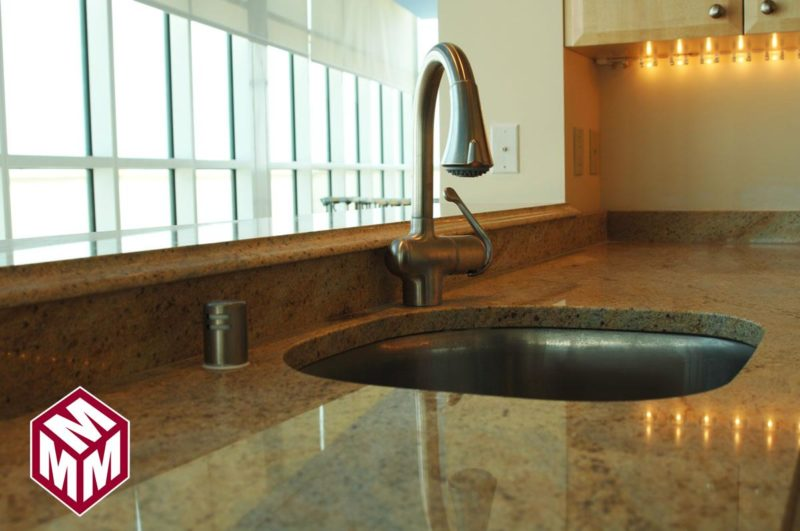 Custom granite counters in kitchen
